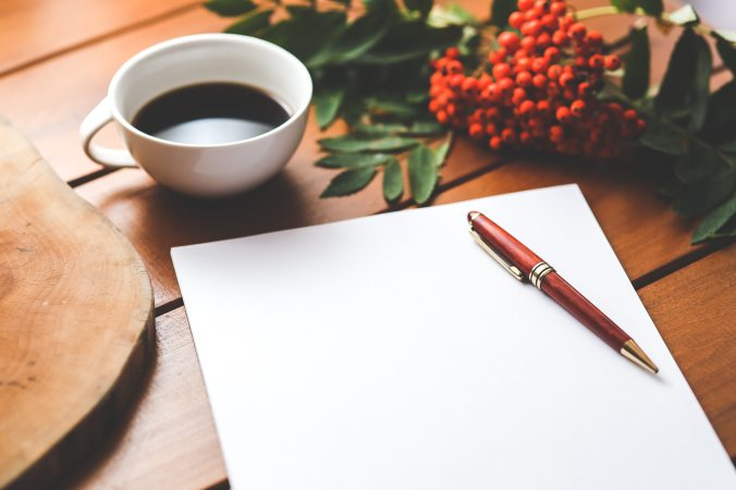 blank-paper-with-pen-and-coffee-cup-on-wood-table-6357